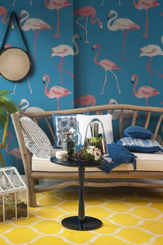 Have you got Flamingo Fever? Bring some charm and personality to your home with this fun tropical wallpaper design. Beautiful flamingos stroll along an intense blue background, giving a funky contrast of colours. It's an exuberant design that would look great in exotic living room spaces.