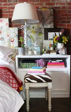Bedside.  I'd love to faux paint the bricks for a  make shift headboard!