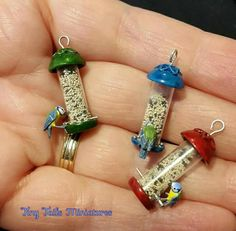 Miniature bluetits on seed feeders, by Tiny Tails Miniatures.