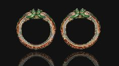A pair of enamelled and gilded parrot head bracelets, North India, 19th century | Lot | Sotheby's