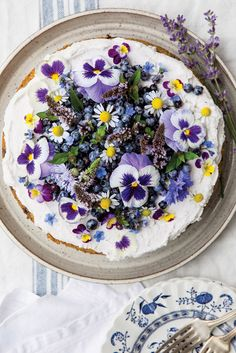 This Wild Blueberry Lemon Poppy Seed Cake with Whipped Coconut Cream is a delectable sweet treat.