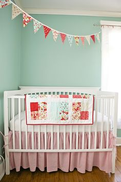 I am not head over heels for this whole nursery, but I love the banner and the bedding.