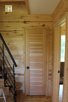 View of interior doors. One panel southern yellow pine. Also showing alternating tread stair up to loft. Modern mountain farmhouse, cabin, corten steel metal roofing, cedar siding, pine paneling interior, marvin windows and doors, casement windows, glulam beams, tongue and groove floor decking, tongue and groove roof deck, SIPs panels, stained concrete floor, open floor plan, loft, alternating tread stair, architectural design, architect, mountain views, front porch, venacular design Stained Concrete, Concrete Floors, Casement Windows, Windows And Doors, Metal Roof, Steel Metal, Sips Panels, Architecture Design, Design Architect