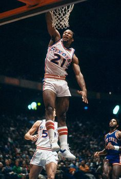 Lloyd Free of the Philadelphia goes up to slam dunk the ball against the New York Knicks during an NBA basketball game circa 1977 at The. Basketball Games Nba, National Basketball League, New York Basketball, Basketball Court Layout, Basketball History, Basketball Goals, Basketball Leagues, Basketball Pictures, Basketball Legends
