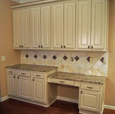 The Tile Backsplash Has Been Reconfigured Throughout The Desk Area And Kitchen New Granite Countertops