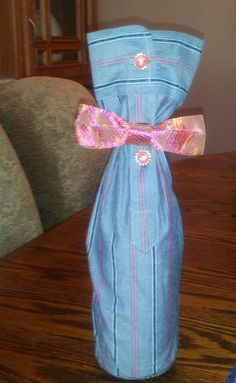 wine bottle cover- sleeve of nice shirt with cute buttons and a bow tie.  Fun idea...