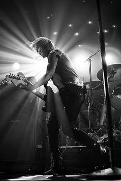 Emily Haines from Metric. Very few things in life hotter than a woman with a guitar