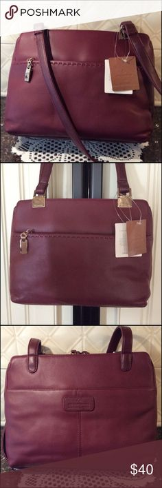 Liz Claiborne Burgundy Handbag Many compartment Handbag. Front & back both have open pockets to slide in your phone for easy access. In the main body on each side is open sections. In the center section of body is a two way zipper which zips all the way down on both sides of Handbag for easy access. In this area is 3 more sections. A center zip section, on the one side of the center section is three small pockets. On the opposite side of the center is a pocket that has credit card slots and…