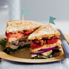 Mouthwatering layers of tender chicken, bacon, beefsteak tomato, and red onion are anchored into this triple-decker sandwich with a slathering of homemade wasabi mayonnaise.