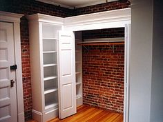 Brick.  White woodwork.  Bookshelf nestled in dead space.