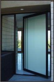 modern and wrouught iron pivot doors