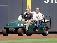 Joe Torre rides onto the field during the ceremony before the game of the game…