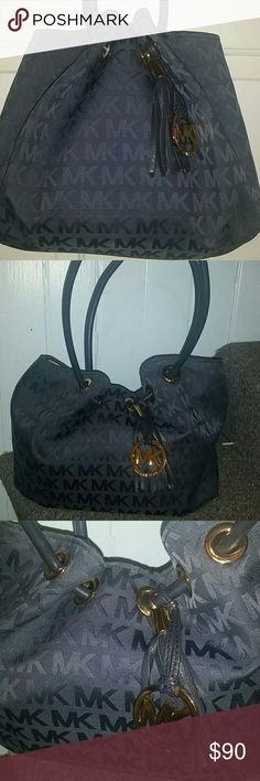 Authentic Michael Kors navy blue pocketbook Authentic Michael Kors navy blue pocketbook with gold accents and tassle - get away from the traditional black MK bags and add some color. Michael Kors Bags
