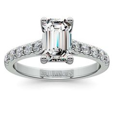 Regal elegance: The Trellis Diamond Ring in stylish White Gold. The prong-set round diamonds add a definitive shimmer to this setting, bringing out the beauty of the Emerald-cut center stone! www.brilliance.com