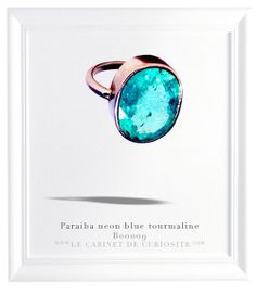 14 carats white gold ring set with a magnificent natural neon blue Paraiba tourmaline