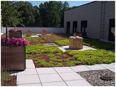 Rooftop Gardens by GreenGrid Roofs. Shows a combination of sitting areas, walkways, and green roof.