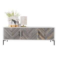 The Amalfi 3 door credenza is perfect for any spaces, with recycled wood doors. Surrounded by a matte white finish, the wood pieces placed on the doors create a large herringbone effect.