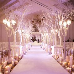 Make your wedding feel like a winter wonderland with white-painted branches lining your aisle and romantic candles illuminating the way.