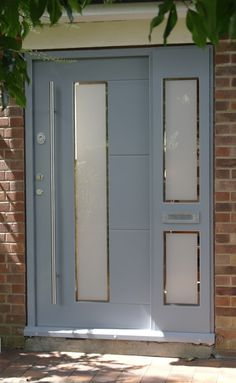 Grey front door with frosted window and etching. Modern design.