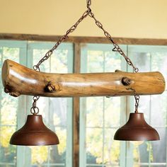 Cabin living room decor with the aspen log light fixture, perfect for over a billiard table. #cabinlife
