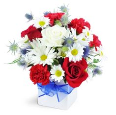 Red White & True!  Bakman Floral Design is a family owned & operated florist in South Lyon, MI committed to offering the finest floral arrangements & gifts, backed by service that is friendly & prompt! Call (248) 437-4168 or visit www.southlyonflorist.com for more info!