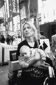 Kim Gordon of Sonic Youth with baby daughter Coco Hayley Moore. Kim Gordon, Rocker Costume, Book Extracts, Half The Sky, Riot Grrrl, People Of Interest, Black White, Vinyl Music, Music Film