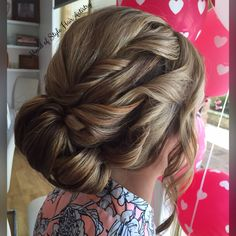 A low curled bun for my gorgeous bride. Hair styled by Chanae Hiller from Ahead of Style Hair Artistry.
