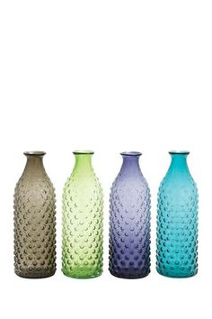 Whether filled with fresh flowers or a dried floral arrangement, the DecMode Assorted Bubble Textured Glass Vase - Set of 4 will make a style statement,. Large Glass Vase, Glass Table, Clear Glass, Bottles And Jars, Glass Bottles, Bottle Vase, Glass Texture, Home Decor Outlet, Colored Glass