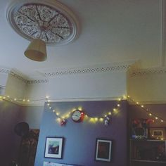 We put fairy lights up last night and now the flat looks  It's raining outside and I don't want to do the 10 second walk to the studio -_-