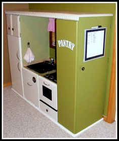 A lovely play kitchen nook, made from a recycled entertainment center I love the pantry for storage great idea!!