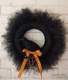How to make a beautiful black Halloween wreath out of tulle. Add a crow and it is the perfectly scary decoration for your Halloween mantel!