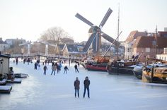 Frozen canals in The Netherlands bring everyone out.