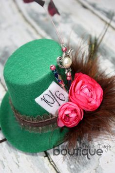 The Mad Hatter hat inspiration. For my sister-in-law's lingerie shower I used a white hat that spelled out BRIDE in crystals and I decorated it with the 10/6 label, flowers, and feathers similar to this pic!