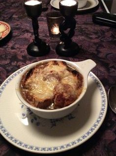 Julia Child's recipe for onion soup. You can make this even days  ahead of time and then add the toasted bread (croutes as Julia calls them) and cheese and bake it the day of.