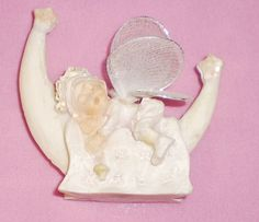 Winged Baby Angel with blanket and dummy sleeping on the Moon Pottery Ornament
