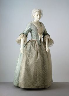 Robe à l'anglaise: ca. 1745 (woven), ca. 1750-1760 (made), ca. 1760-1770 (altered), silk damask, lined with linen, hand-sewn, (shown with an silk apron, a cap, fichu, engageantes).