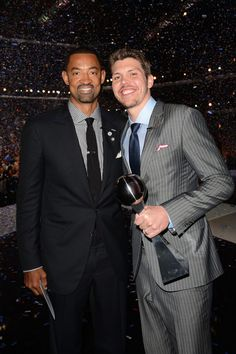 Miami Heat Juwan Howard and Mike Miller looking very stylish at the 2012 ESPY Awards and went on stage to receive the 2012 Best Team Award on behalf of their team. Juwan Howard wore a black suit and tie and a black vichy shirt while Mike Miller wore a grey striped suit with a navy blue tie and a pale blue shirt. A season to remember for the Heat!