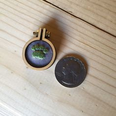 Small Pendant Cat Paw-green floss on gray fabric by CircleGGoods