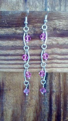 Silver and pink swarvoski crystal dangle earrings by Natjerm, $15.00