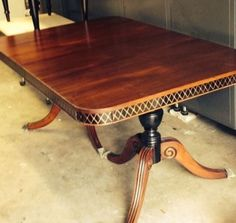 Gorgeous refinished 1930-40's Duncan Phyfe table.  Besides being stripped and new stain being applied, I painted the table skirt and base black and hand painted diamonds in gold.  Stunning. SOLD!Tamarabeard1@gmail.com
