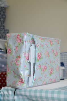 My DIY laminate fabric sewing machine cover. Idea??? I like the pocket for the table.