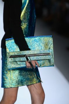 Milly: Starting the workweek on a glamorous note sounds good to us, and this funky metallic Milly clutch has that covered. Place an iPad, smartphone, or notebook inside, and you're set to take on the week.
