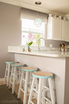 Simple DIY, upgrading barstools by adding a colorful aqua band / danielle oakey interiors: Cuckoo 4 Design Home Tour!