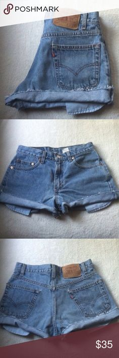 """Levi's high waist jean shorts Size 10 •Excellent used condition •Originally a bit longer, and then customized into cutoffs for a more distressed look •Light Wash •Brand:Levi's •Style: 550- High waist, relaxed fit •Size: 10 (30"""" waist) •NO TRADES  •FREE GIFT WITH ANY PURCHASE•15% OFF ALL BUNDLES• Levi's Shorts Jean Shorts"""