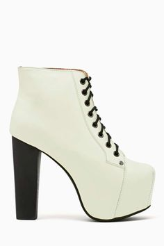 Jeffrey Campbell Lita Platform Boot - Glow In The Dark THIS IS AWESOME! $162.00 Towering lace-up platform boots featuring glow in the dark fabric and a chunky black heel. Genuine leather interior, non-slip sole. By Jeffrey Campbell.