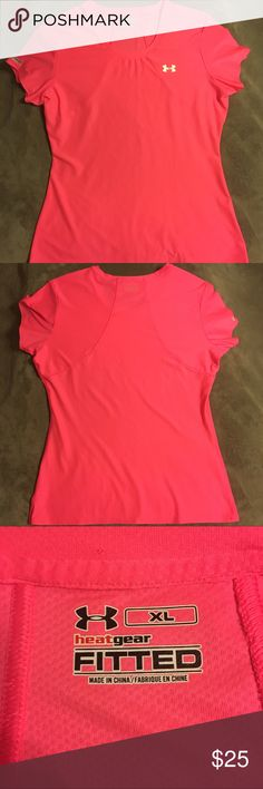 BRAND NEW Under Armour Fitted Heatgear Shirt Hot pink women's fitted heatgear shirt from Under Armour. Never worn. Goes perfectly with the pink UA sports bra and purple Soffee shorts in my closet! Perfect for a run! Under Armour Tops Tees - Short Sleeve