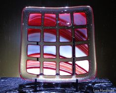 This is a (approximately 5 square slumped fused glass bowl shaped dish. It is a clear dish with squares streaked with white, orange and red on it in rows. This piece is food safe. Bottle Slumping, Fused Glass Bowl, Glass Beer Mugs, Getting Fired, Square Plates, Hostess Gifts, Safe Food, Squares, Liquor
