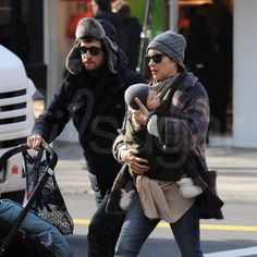 Guillaume Canet and Marion Cotillard walked side by side in NYC with baby Marcel snuggled up close to mom.