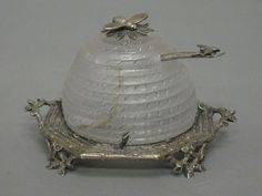 cut glass honey pot in the form of a beehive with bee finial