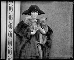 A 1922 portrait of actress Mrs. Vernon Castle holding two small dogs. Photograph by Chicago Daily News, Inc.